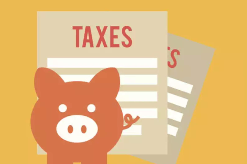 An image with Taxes written and a picture of piggy on the front.
